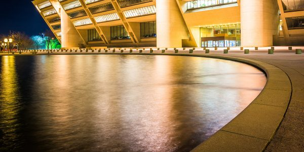 City Hall and a reflecting pool at night, in Dallas, Texas